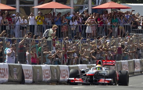Lewis Hamilton with the Vodafone McLaren Mercedes F1 racing car in action during the Moscow City Race on the 15th of July 2012.