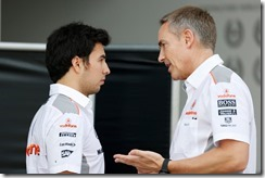 Sergio Perez in conversation with Martin Whitmarsh.