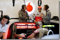 Sergio Perez with the team in the garage