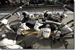 Kevin Magnussen makes a pit stop.
