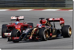 Sepang International Circuit, Sepang, Kuala Lumpur, Malaysia. Sunday 30 March 2014. Romain Grosjean, Lotus E22 Renault, leads Fernando Alonso, Ferrari F14T. Photo: Glenn Dunbar/Lotus F1 Team. ref: Digital Image _89P5838