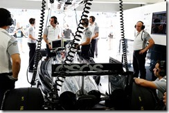 The team work on the car of Kevin Magnussen in the garage.