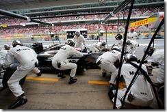 Jenson Button makes a pit stop.