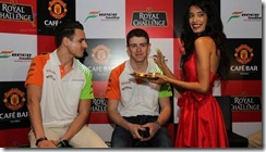 Adrian_Sutil-and-Paul_di_Resta-with-actress_Sarah_Jane_Dias