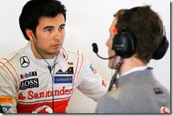 Sergio Perez in conversation in the garage.