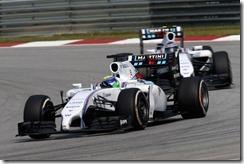 Sepang International Circuit, Sepang, Kuala Lumpur, Malaysia. Sunday 30 March 2014. Felipe Massa, Williams FW36 Mercedes, leads Valterri Bottas, Williams FW36 Mercedes. Photo: Glenn Dunbar/Williams F1. ref: Digital Image _89P5834