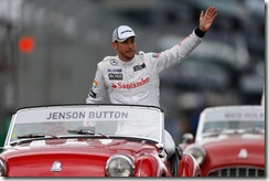Jenson Button waves to the crowd during the drivers parade.