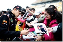 Shanghai International Circuit, Shanghai, China. Thursday 17 April 2014. Pastor Maldonado, Lotus F1, signs autographs for fans. World Copyright: Glenn Dunbar/Lotus F1.. ref: Digital Image _W2Q2251