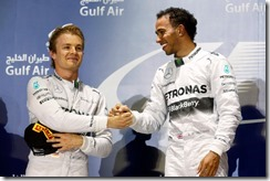 Bahrain International Circuit, Sakhir, Bahrain. Sunday 06 April 2014. Nico Rosberg, Mercedes AMG and Lewis Hamilton, Mercedes W05 celebrate on the podium. World Copyright: Alastair Staley/LAT Photographic. ref: Digital Image _R6T4480.JPG