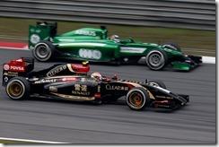 Shanghai International Circuit, Shanghai, China. Sunday 20 April 2014. Pastor Maldonado, Lotus E22 Renault, passes Kamui Kobayashi, Caterham CT05 Renault. Photo: Glenn Dunbar/Lotus F1 Team. ref: Digital Image _89P2470