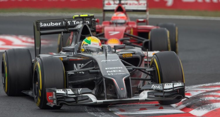 Esteban_Gutierrez-leading-Kimi_Raikkonen-Hungarian_GP-2014.jpg